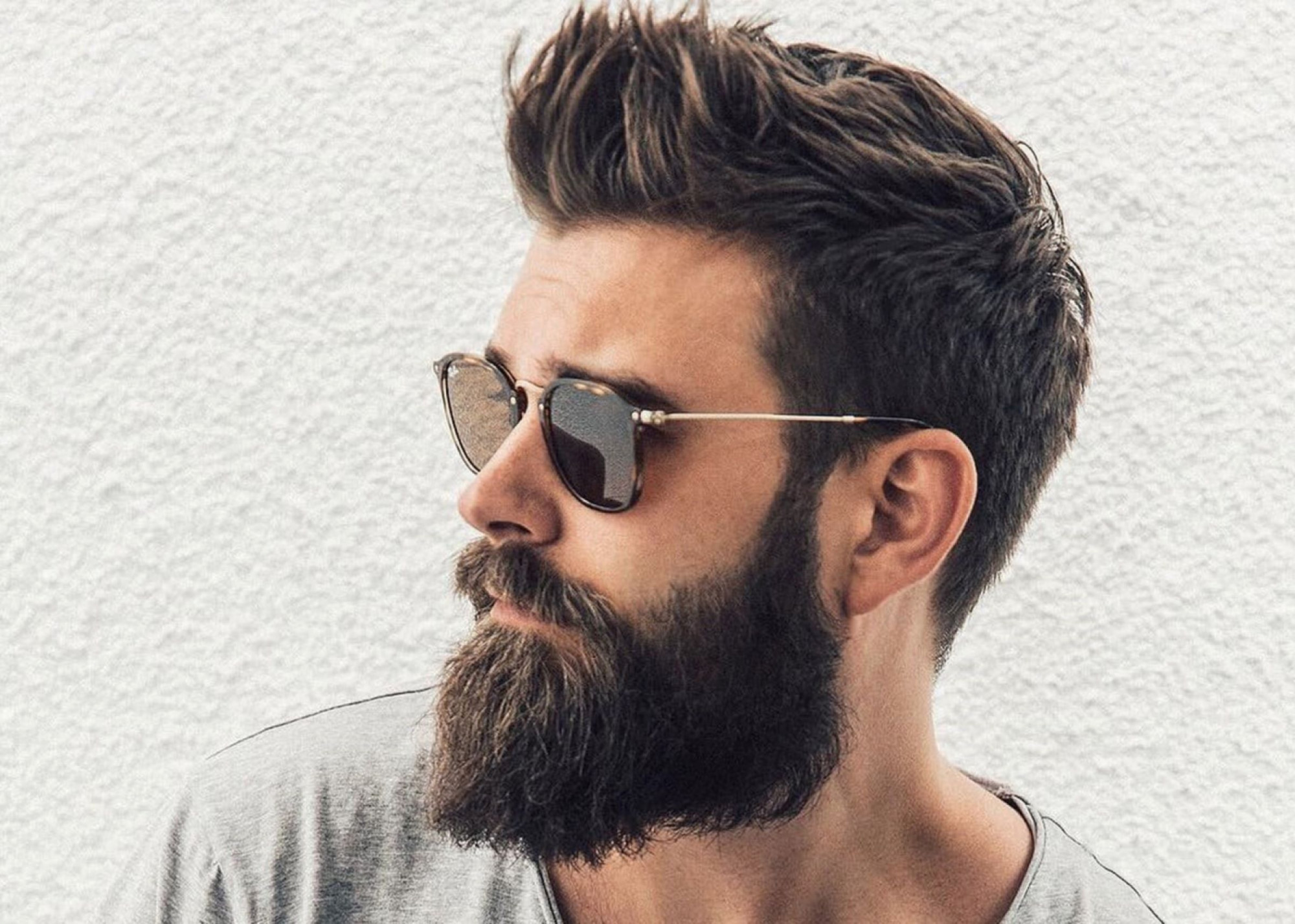 What do beards symbolize and the different styles men wear